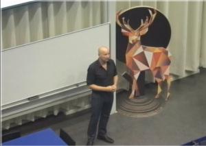 Hans Bouwknegt tijdens zijn lezing aan de HvA